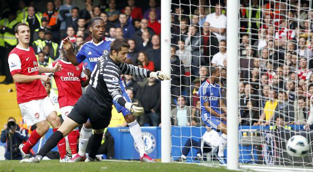 Didier Drogba scores against Arsenal. Photo: Getty Images