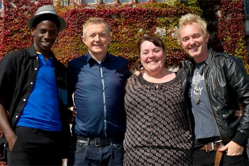 Mary Byrne with X Factor judge Louis Walsh and fellow contestants John (left) and Storm Lee