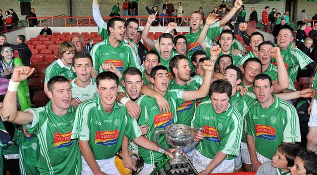 The Kilmallock team celebrate with the cup following their four point victory over Emmets in the Limerick SHC final yesterday. Photo: Diarmuid Greene / Sportsfile