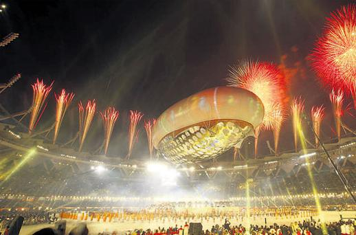 Fireworks illuminate the Jawaharlal Nehru Stadium during the opening ceremony for the Commonwealth Games in New Delhi yesterday.