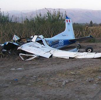 The remains of a crashed plane in Nazca, Peru, in which four Britons died (AP)