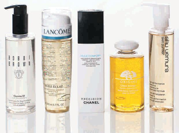 Pictured, from left: Bobbi Brown Cleansing Oil; Lancome Huile Eclat; Chanel Huile Confort; Origins Clean Energy Gentle Cleansing Oil; Shu Uemura High-Performance Balancing Cleansing Oil