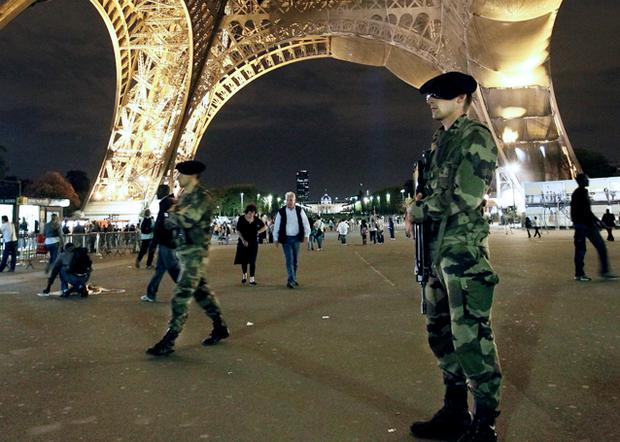 French soldiers patrol under the Eiffel Tower in Paris, which was evacuated on Tuesday following a bomb threat called in from a telephone booth. Photo: Getty Images