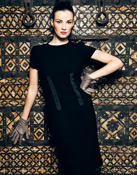 Wool crepe dress with grosgrain ribbon detail down the front, €285, Peter O'Brien; grey leather gloves, €55, Gala