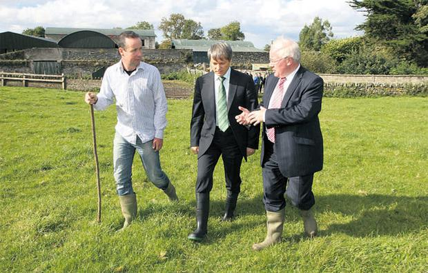 EU Agriculture Commissioner Dacian Ciolos (centre) listens to Agriculture Minister Brendan Smith (right) as Ireland's main man puts his ideas across on the visit to Stephen Morrison's (left) sheep and suckler beef farm in Co Kildare