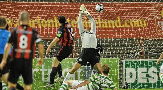 Jason Byrne guides the ball past Shamrock Rovers goalkeeper Alan Mannus to score what proved to be the winner at Dalymount Park. Photo: David Maher / Sportsfile