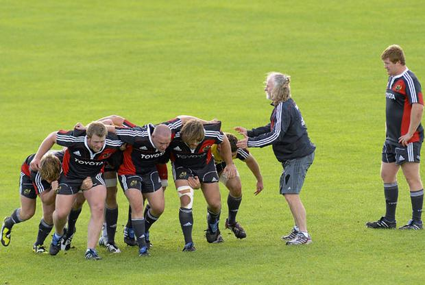 Laurie Fisher puts the Munster forwards through their paces during training in Limerick yesterday. Photo: Diarmuid Greene / Sportsfile