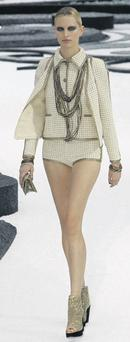A modern twist on the Chanel suit during Paris Fashion Week. AP/ CHRISTOPHE ENA