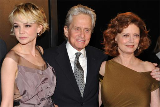 Michael Douglas posing on the red carpet at the New York premiere of the new film with his co-stars Carey Mulligan and Susan Sarandon