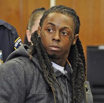 Rapper Lil Wayne was sentenced to a year in jail for having a loaded gun on his tour bus in 2007