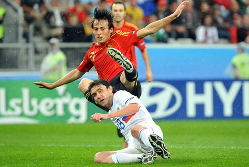 Yuri Zhirkov, seen here tackling Spain's David Silva, is likely to be in action for Russia at the Aviva Stadium on Friday night. Photo: Pat Murphy / Sportsfile