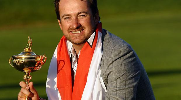 Graeme McDowell poses with the trophy after helping Europe win the Ryder Cup at Celtic Manor last Monday. Photo: Getty Images