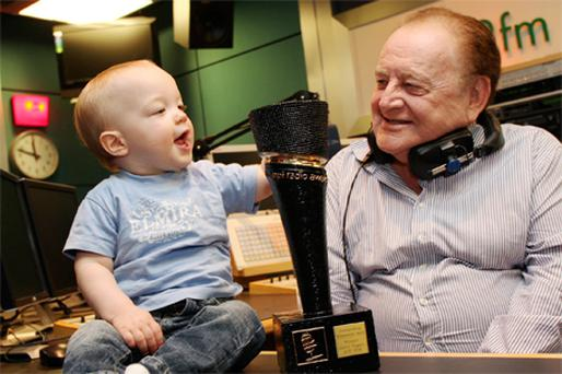 2fm DJ Larry Gogan shows his youngest fan, 13- month-old Joshua Harman, his Outstanding Achievement Award 2010 which will be formally presented at the annual PPI Radio Awards tomorrow