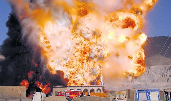 Trucks carrying fuel supplies to NATO forces in Afghanistan explode after an attack in the outskirts of Quetta, Pakistan