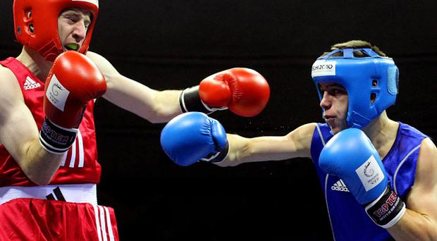 Northern Ireland's Paddy Barnes (red) in action against Scotland's Iain Butcher in the Light Fly 46-49kg during the Commonwealth Games. Photo: PA