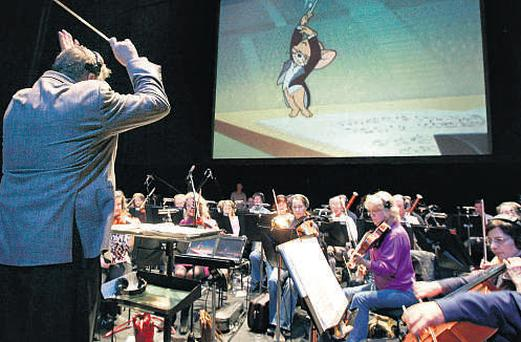 Emmy Award-winning conductor George Daugherty leads the RTE Symphony Orchestra during rehearsals in time to Looney Tunes cartoons