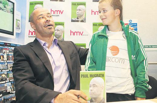 Paul McGrath meets Jack Walsh (11) from Co Kerry at the launch of his DVD at HMV on Grafton Street, Dublin, yesterday