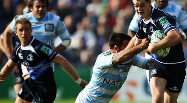 Jonathan Sexton is tackled by John Leo'o during the Heineken Cup match between Leinster and Racing Metro 92 at the Royal Dublin Society. Photo: Getty Images