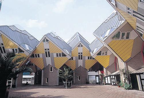TIPSY TURVY: The Oudehaven district is home to Europe's oldest skyscraper and architect Piet Blom's yellow cube houses.