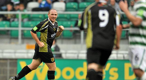 Glen Crowe turns away in celebration after scoring the winner for Sporting Fingal.
