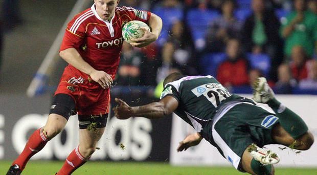 Munster's Keith Earls gives Chris Hala'ufia the slip during Saturday's Heineken Cup clash at the Madejski Stadium. Photo: Matthew Impey / Sportsfile