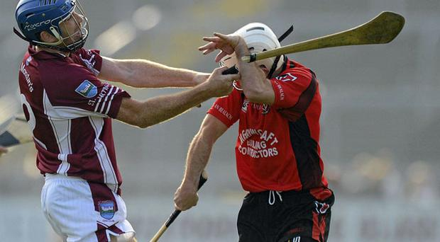 Diarmuid Lyng of St Martin's breaks his hurley across the left arm of his opponent Des Mythen in the Wexford SHC final. Photo: Matt Browne / Sportsfile