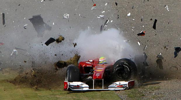 Debris flies as Ferrari's Felipe Massa spins out on the first bend after colliding with Force India's Vitantonio Liuzzi at the Japanese F1 Grand Prix at Suzuka.