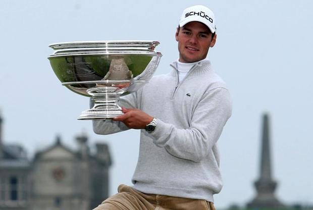 Martin Kaymer stands on the Swilkin Bridge at St Andrews yesterday with his Alfred Dunhill Links trophy after claiming his third tournament win in-a-row.