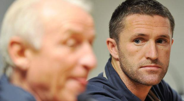 Ireland captain Robbie Keane in pensive mood as he listens to Giovanni Trapattoni answering a question at a press conference in Zilina. Photo: David Maher / Sportsfile