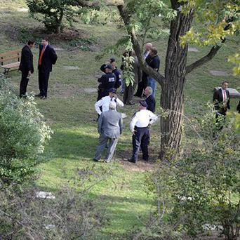 New York City police stand inside the grounds of the NYC Marble Cemetery where explosives were found (AP)