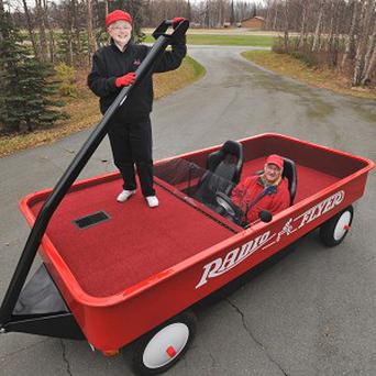 Judy Foster and Fred Keller in their giant red Radio Flyer wagon (AP)