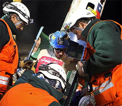 19-year-old Jimmy Sanchez is assisted in leaving the capsule as the fifth miner safely rescued from the mine. Photo: Reuters