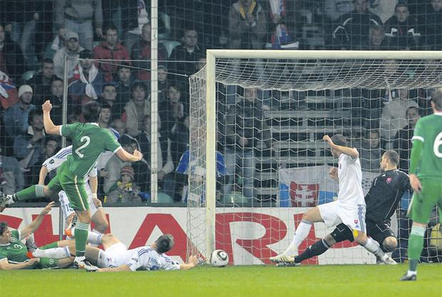 Sean St Ledger (no 2) puts Ireland in front during their Group B game against Slovakia in Zilina