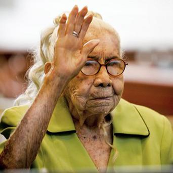 Eulalia Garcia-Maturey, 101, raises her right hand during a naturalisation ceremony in Texas (AP)