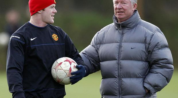 Wayne Rooney with manager Alex Ferguson. Photo: Getty Images