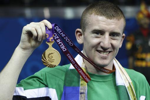 Belfast boxer Paddy Barnes holds up his gold medal after winning the men's light flyweight final at the Commonwealth Games.