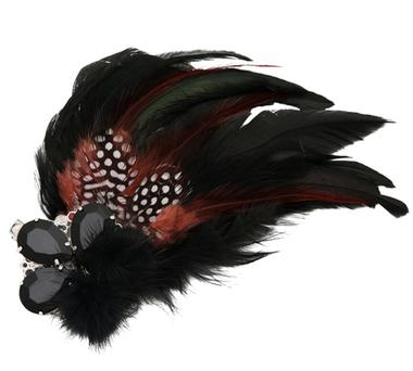 Turn heads with a clever take on the classic 'up do' with this feathered head piece from Awear - €10.00.