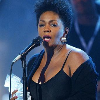 Anita Baker is being sued by a house-painting company