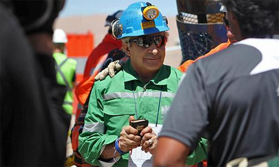 Trapped miner Omar Reygadas clutches a bible after reaching the surface to become the 17th to be rescued from the San Jose mine in Copiapo, Chile. Photo: Reuters