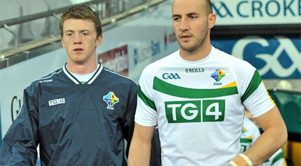 Ireland's Kevin Reilly, left, and Tadhg Kennelly arrive onto the pitch for training last night