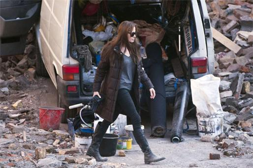 US actress Angelina Jolie walks in a scene during the shooting of her directorial debut