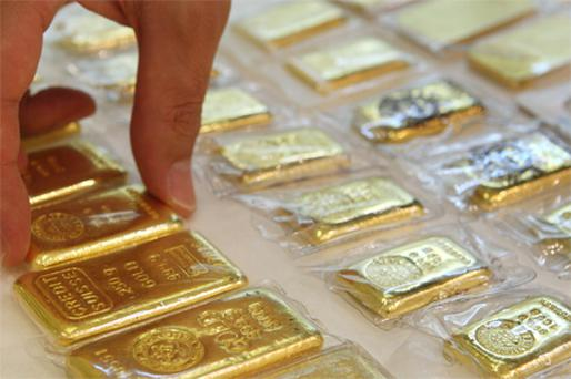 Gold reached a record $1,387.35 an ounce yesterday. Photo: Bloomberg News