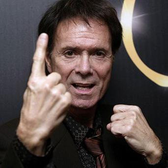 Sir Cliff Richard is celebrating his 70th birthday with a quiet night in