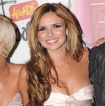 Nadine Coyle says she has always worked separately from the rest of Girls Aloud
