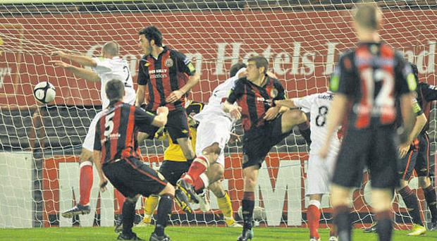 Gavin Peers, left, scores Sligo Rovers' winning goal from a corner in last night's FAI Ford Cup semi-final against Bohemians.