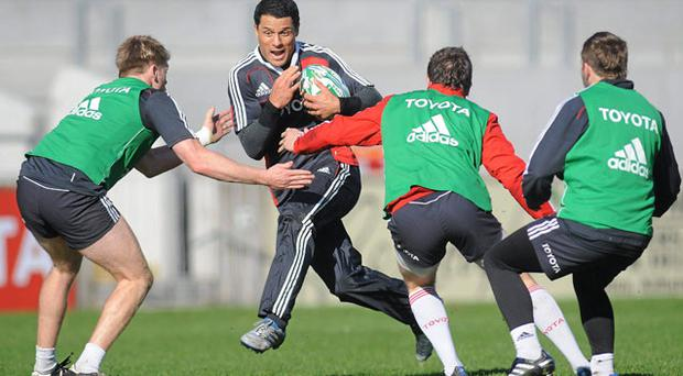 Munster's Doug Howlett takes on three opponents during a squad training session earlier in the week.