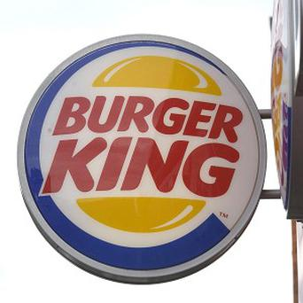 A US man has settled a lawsuit with Burger King over an unwrapped condom