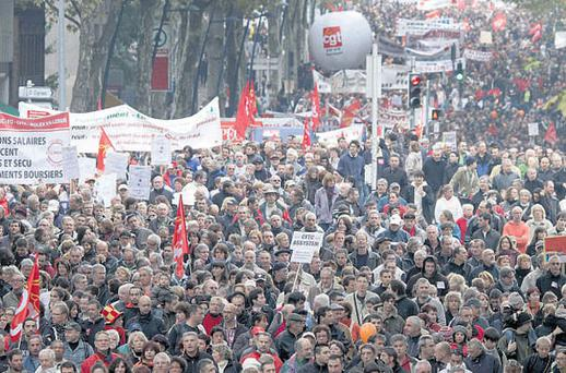 TAKING TO THE STREETS: Workers demonstrate in the southern French city of Toulouse yesterday.