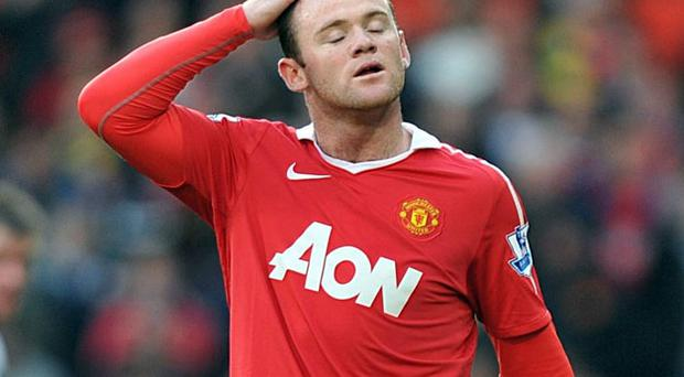 Wayne Rooney holds his head as Manchester United are frustrated at Old Trafford on Saturday.