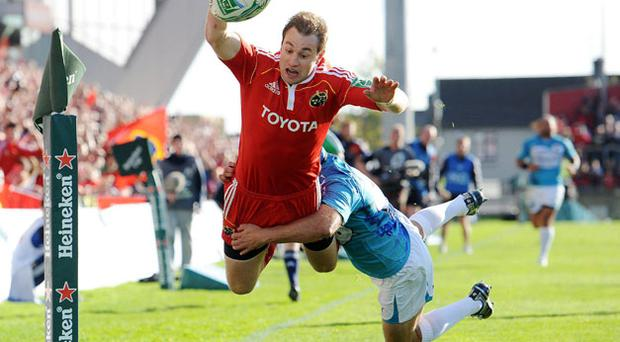 Munster's Johne Murphy dives over the line despite the efforts of Felipe Contepomi only for the 'try' to be disallowed ater a ruling by the video referee. Photo: Matt Browne / Sportsfile